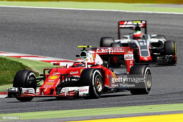 Kimi Raikkonen of Finland driving the Scuderia Ferrari SF16H Ferrari 059/5 turbo leads Esteban Gutierrez of Mexico driving the Haas F1 Team...