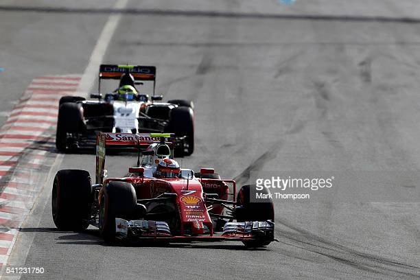 Kimi Raikkonen of Finland driving the Scuderia Ferrari SF16H Ferrari 059/5 turbo leads Sergio Perez of Mexico driving the Sahara Force India F1 Team...
