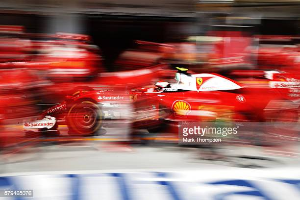 Kimi Raikkonen of Finland driving the Scuderia Ferrari SF16H Ferrari 059/5 turbo makes a pit stop during the Formula One Grand Prix of Hungary at...
