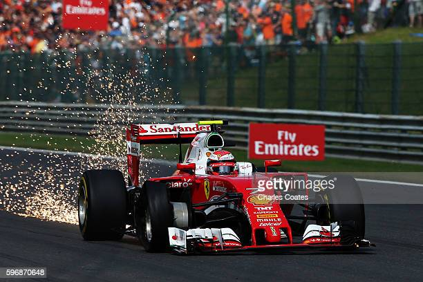 Kimi Raikkonen of Finland driving the Scuderia Ferrari SF16H Ferrari 059/5 turbo with a punctured tyre during the Formula One Grand Prix of Belgium...