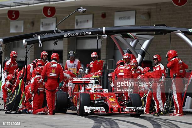 Kimi Raikkonen of Finland driving the Scuderia Ferrari SF16H Ferrari 059/5 turbo makes a pit stop for new tyres during the United States Formula One...