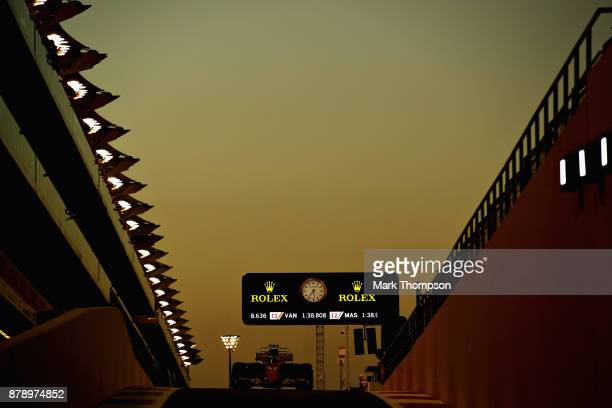 Kimi Raikkonen of Finland driving the Scuderia Ferrari SF70H in the Pitlane during qualifying for the Abu Dhabi Formula One Grand Prix at Yas Marina...