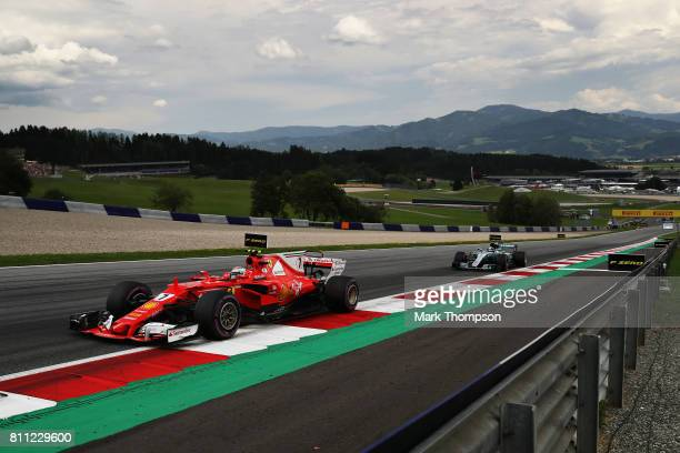 Kimi Raikkonen of Finland driving the Scuderia Ferrari SF70H leads Valtteri Bottas driving the Mercedes AMG Petronas F1 Team Mercedes F1 WO8 on track...