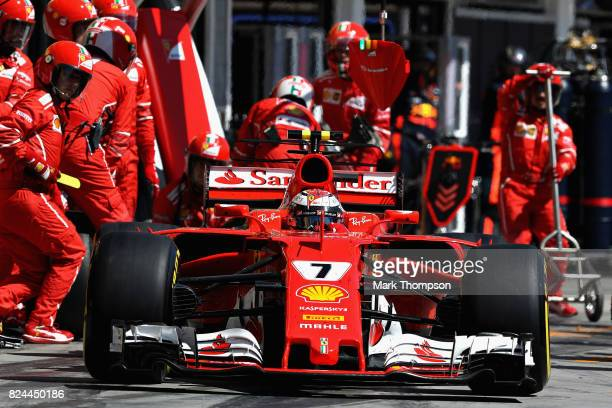 Kimi Raikkonen of Finland driving the Scuderia Ferrari SF70H makes a pit stop for new tyres during the Formula One Grand Prix of Hungary at...