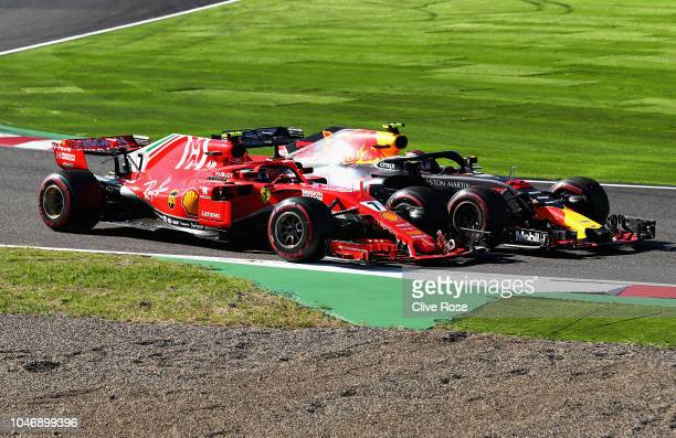 Kimi Raikkonen of Finland driving the Scuderia Ferrari SF71H and Max Verstappen of the Netherlands driving the Aston Martin Red Bull Racing RB14 TAG...
