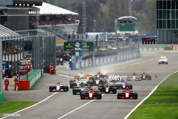 Kimi Raikkonen of Finland driving the Scuderia Ferrari SF71H and Sebastian Vettel of Germany driving the Scuderia Ferrari SF71H race to the first...