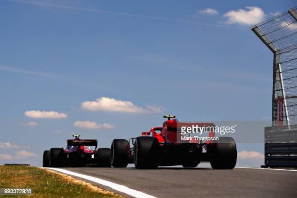 Kimi Raikkonen of Finland driving the Scuderia Ferrari SF71H follows Charles Leclerc of Monaco driving the Alfa Romeo Sauber F1 Team C37 Ferrari on...