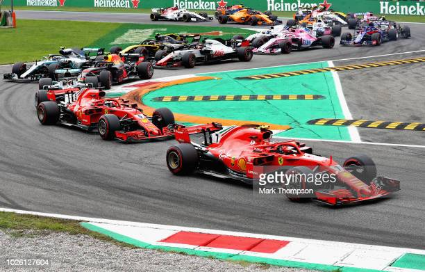 Kimi Raikkonen of Finland driving the Scuderia Ferrari SF71H leads Sebastian Vettel of Germany driving the Scuderia Ferrari SF71H and the rest of the...