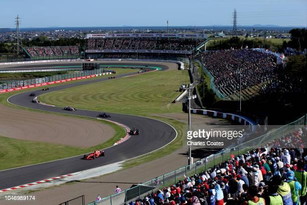 Kimi Raikkonen of Finland driving the Scuderia Ferrari SF71H leads Romain Grosjean of France driving the Haas F1 Team VF18 Ferrari on track during...