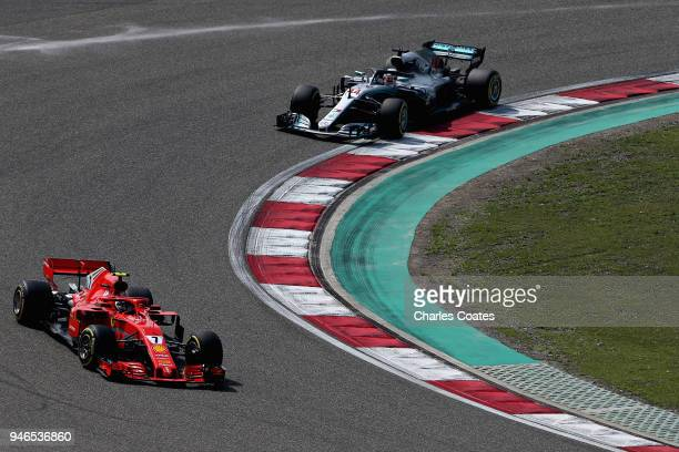 Kimi Raikkonen of Finland driving the Scuderia Ferrari SF71H leads Lewis Hamilton of Great Britain driving the Mercedes AMG Petronas F1 Team Mercedes...