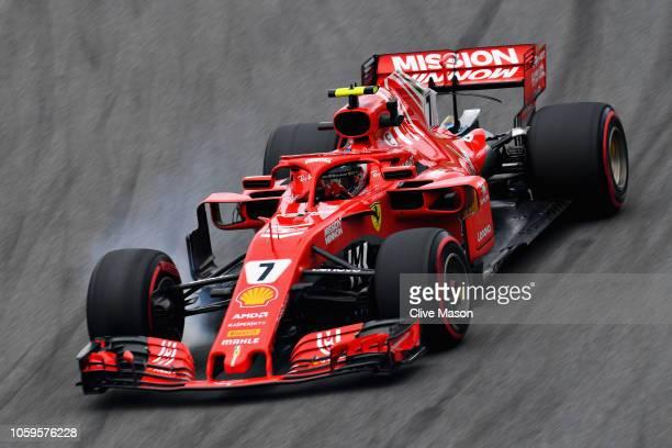 Kimi Raikkonen of Finland driving the Scuderia Ferrari SF71H locks a wheel under braking during practice for the Formula One Grand Prix of Brazil at...