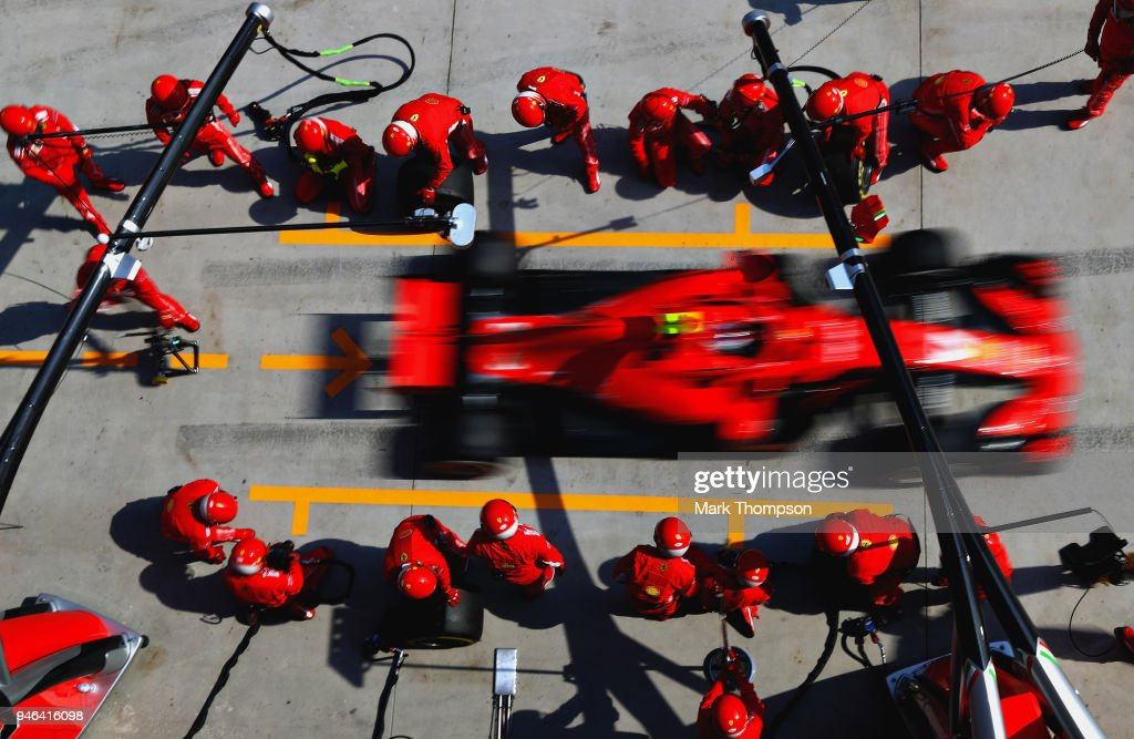 Kimi Raikkonen of Finland driving the (7) Scuderia Ferrari SF71H makes a pit stop for new tyres during the Formula One Grand Prix of China at Shanghai International Circuit on April 15, 2018 in Shanghai, China.