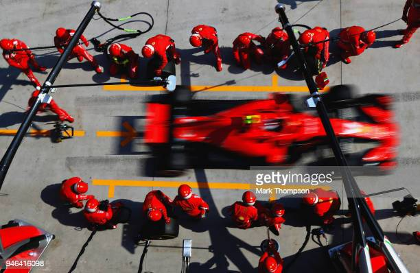 Kimi Raikkonen of Finland driving the Scuderia Ferrari SF71H makes a pit stop for new tyres during the Formula One Grand Prix of China at Shanghai...