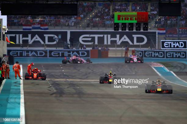 Kimi Raikkonen of Finland driving the Scuderia Ferrari SF71H stops on the pit straight during the Abu Dhabi Formula One Grand Prix at Yas Marina...