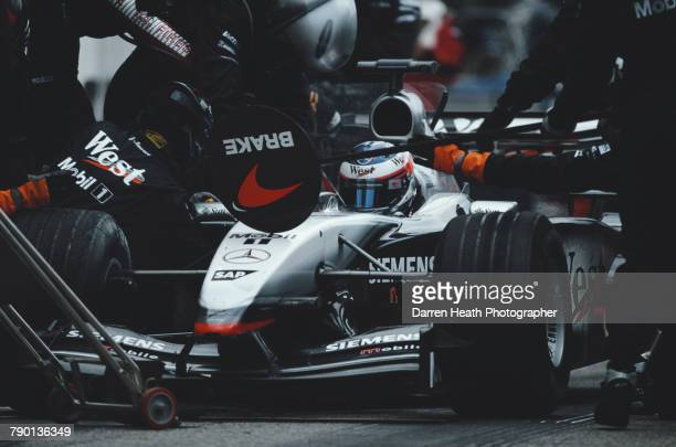 Kimi Raikkonen of Finland makes a pit stop with the West McLaren Mercedes McLaren MP417D Mercedes V10 during the Formula One San Marino Grand Prix on...