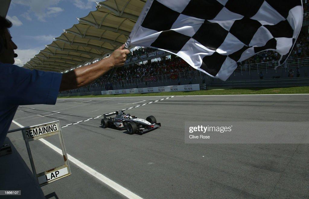 Kimi Raikkonen of McLaren and Finland crosses the line to win the Malaysian Grand Prix at the Sepang International Circuit in Kuala Lumpur, Malaysia on March 23, 2003.