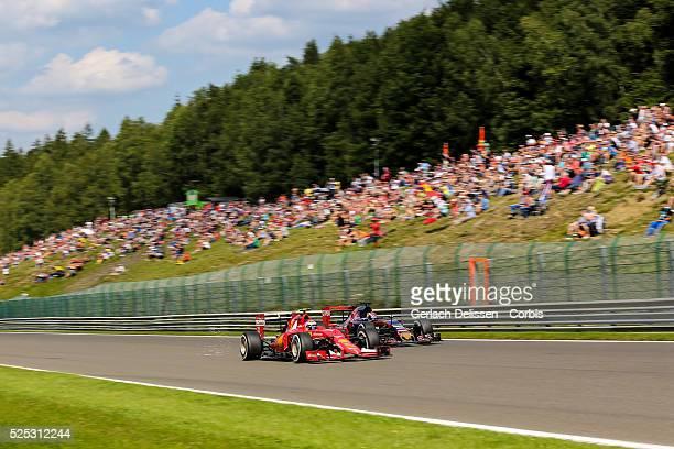 Kimi Raikkonen of the Scuderia Ferrari Team passing Max Verstappen of the Scuderia Toro Rosso Team during the 2015 Formula 1 Shell Belgian Grand Prix...