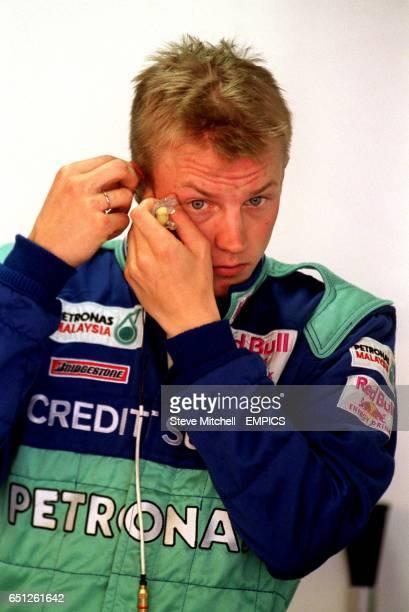 Kimi Raikkonen puts in his earplugs for practice for the Brazilian Grand Prix