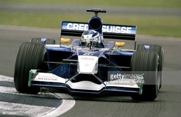 Kimi Raikkonen takes a corner on practice day at the British Grand Prix