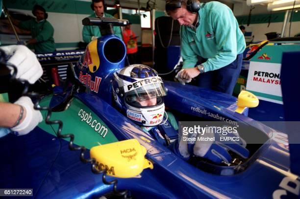 Kimi Raikkonen waits in his Sauber