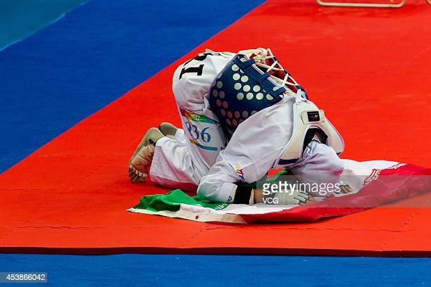 Kimia Alizadeh Zenoorin of Iran celebrates after beating Yulia Turutina of Russia in the Taekwondo Women's 63kg final match on day four of the...