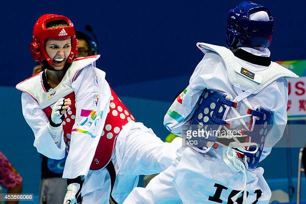 Kimia Alizadeh Zenoorin of Iran competes with Yulia Turutina of Russia in the Taekwondo Women's 63kg final match on day four of the Nanjing 2014...
