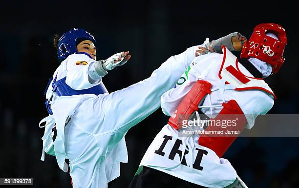 Kimia Alizadeh Zenoorin of Iran cries during the Women's Taekwondo 57kg quarter finals at the Carioca Arena on Day 13 of the 2016 Rio Olympic Games...