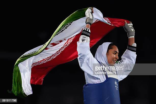 Kimia Alizadeh Zenoorin of the Islamic Republic of Iran celebrates after defeating Nikita Glasnovic of Sweden during the Women's 57kg Bronze Medal...