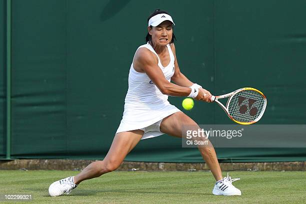 Kimiko Date Krumm of Japan in action during the first round match against Alexandra Dulgheru of Romania on Day Two of the Wimbledon Lawn Tennis...