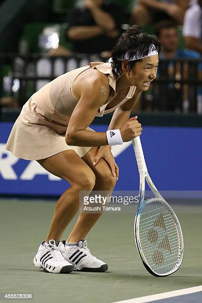 Kimiko Date of Japan in pain during her women's singles match against Victoria Azarenka of Belarus during day two of the Toray Pan Pacific Open at...