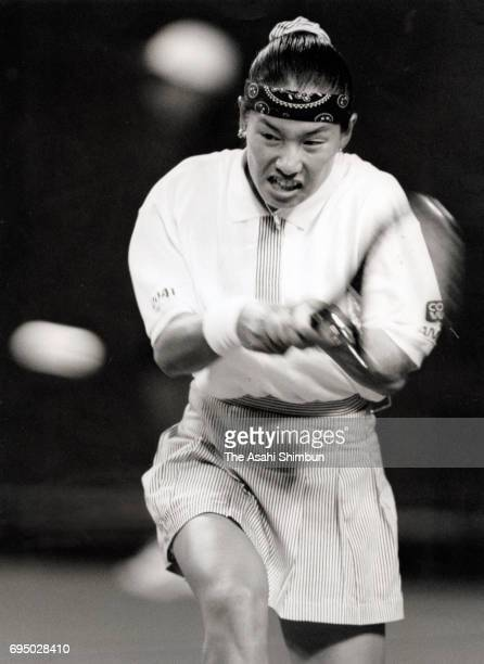Kimiko Date of Japan plays a backhand during day one of the FED Cup World Group Quarterfinal between Japan and Germany at Ariake Coliseum on April 27...