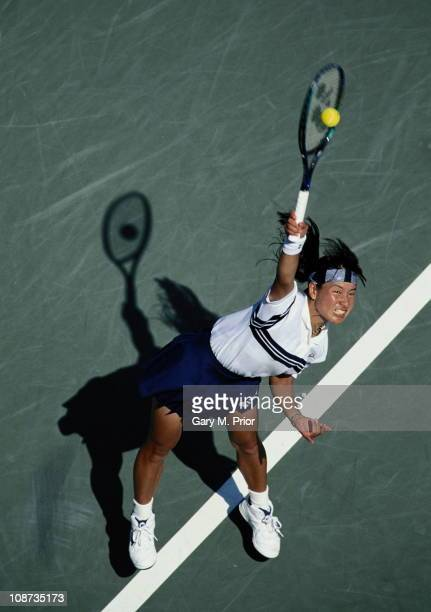 Kimiko Date of Japan serves to Brenda Schultz McCarthy during the USOpen Tennis Championship on 4th September 1995 at the USTA National Tennis Center...