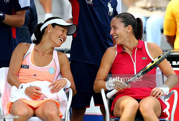 Kimiko DateKrumm of Japan and Arantxa Parra Santonja of Spain during their women's doubles first round match against Andrea Hlavackova and Lucie...