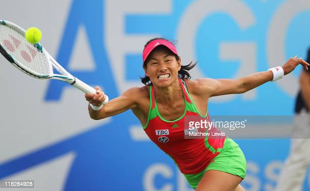 Kimiko DateKrumm of Japan plays a backhand during her match against Sabine Lisicki of Germany during the first day of the AEGON Classic at the...