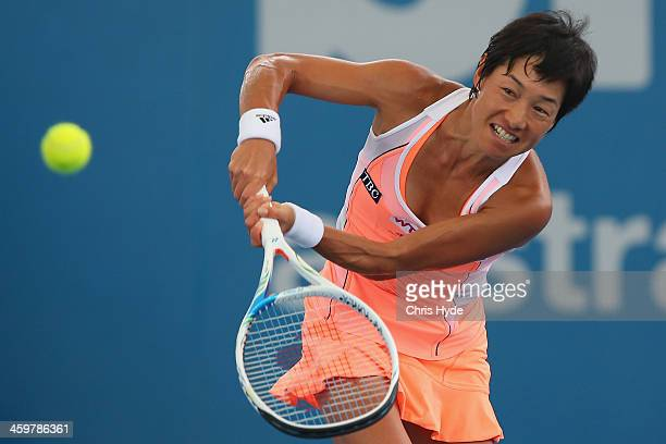 Kimiko DateKrumm of Japan plays a backhand in her match against Dominika Cibulkova of Slovakia during day three of the 2014 Brisbane International at...