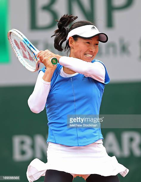 Kimiko DateKrumm of Japan plays a backhand in her Women's Singles match against Samantha Stosur of Australia during day three of the French Open at...