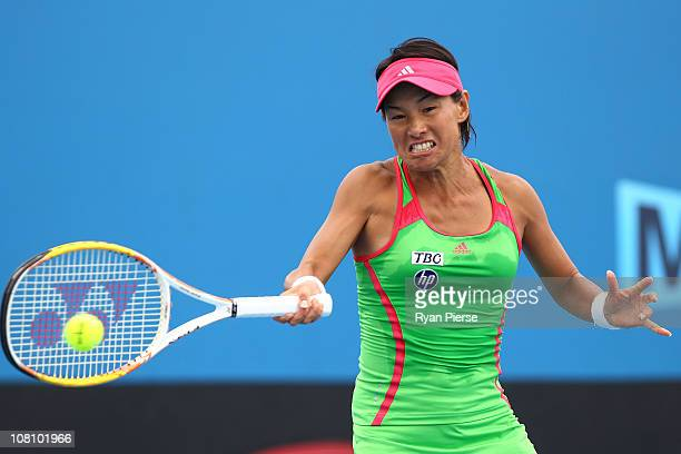 Kimiko DateKrumm of Japan plays a forehand during her first round match against Agnieszka Radwanska of Poland during day two of the 2011 Australian...