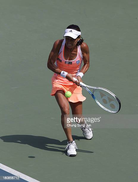 Kimiko DateKrumm of Japan plays a shot against Heather Watson of Great Britain during day two of the KDB Korea Open 2013 at Seoul Olympic Park Tennis...