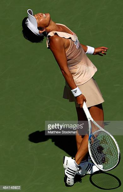 Kimiko DateKrumm of Japan reacts against Venus Williams of the United States during her women's singles first round match on Day One of the 2014 US...