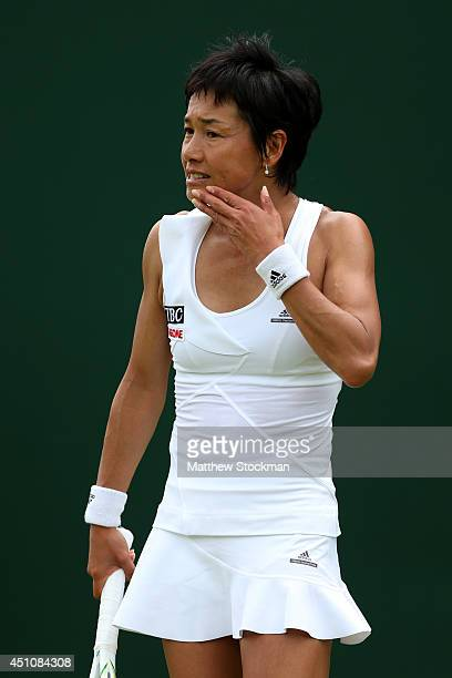Kimiko DateKrumm of Japan reacts during the Ladies' Singles first round match against Ekaterina Makarova of Russia on day one of the Wimbledon Lawn...
