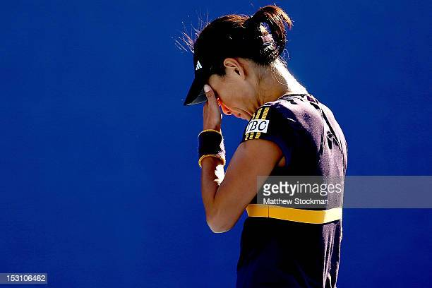 Kimiko DateKrumm of Japan reacts to a lost point while playing Laura Robson of Great Britain during the China Open at the China National Tennis...
