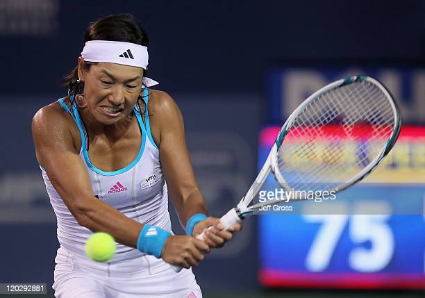 Kimiko DateKrumm of Japan returns a backhand to Sabine Lisicki of Germany during the Mercury Insurance Open presented by TriCity Medical at the La...