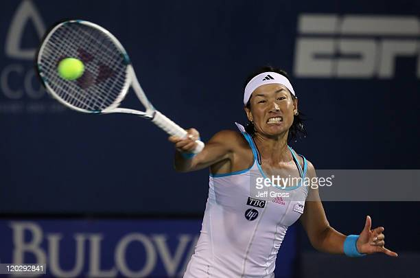 Kimiko DateKrumm of Japan returns a forehand to Sabine Lisicki of Germany during the Mercury Insurance Open presented by TriCity Medical at the La...
