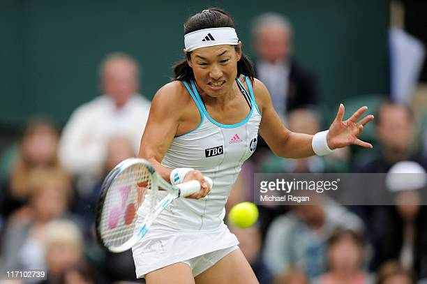 Kimiko DateKrumm of Japan returns a shot during her second round match against Venus Williams of the United States on Day Three of the Wimbledon Lawn...