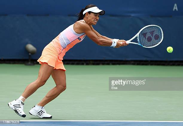 Kimiko DateKrumm of Japan returns a shot during their women's doubles first round match against Andrea Hlavackova and Lucie Hradecka of the Czech...