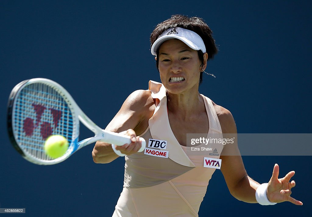 Kimiko Date-Krumm of Japan returns a shot to Kaolina Pliskova of the Czech Republic during Day 1 of the Bank of the West Classic at the Taube Family Tennis Stadium on July 28, 2014 in Stanford, California.