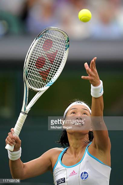 Kimiko DateKrumm of Japan serves during her second round match against Venus Williams of the United States on Day Three of the Wimbledon Lawn Tennis...