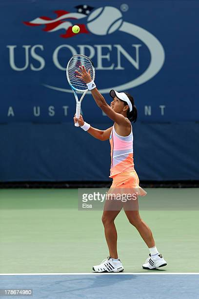 Kimiko DateKrumm of Japan serves during her women's doubles first round match against Andrea Hlavackova and Lucie Hradecka of the Czech Republicon on...