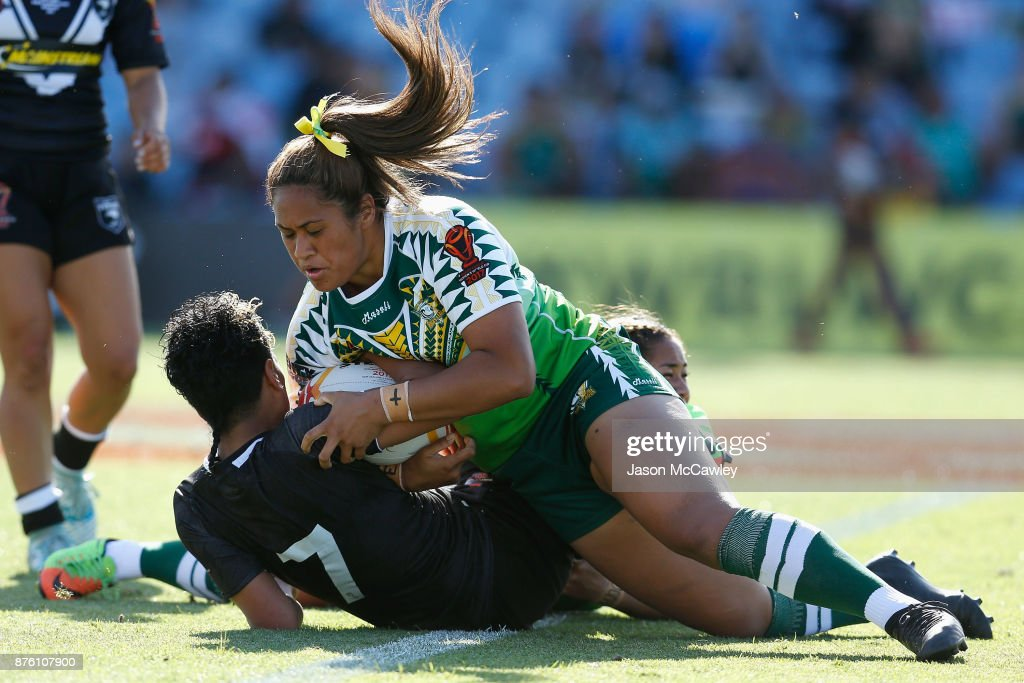 Kimiora Nati of New Zealand is tackled by Kaylen Ikitule of the Cook Islands during the 2017 Women's Rugby League World Cup match between New Zealand and Cook Islands at Southern Cross Group Stadium on November 19, 2017 in Sydney, Australia.