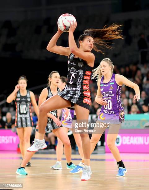 Kimiora Poi of the Magpies competes for the ball during the round 9 Super Netball match between the Magpies and the Firebirds at Melbourne Arena on...